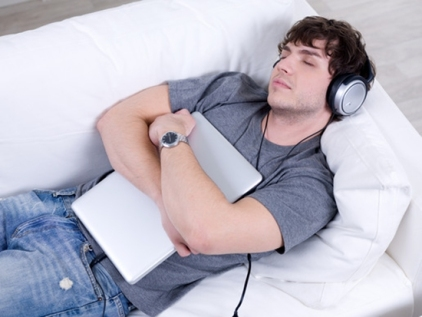 Sleeping man with headphone and laptop